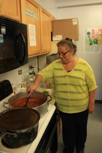 Principal Laurie Beam cooks up a pasta dish for the potluck. Allakaket 2014.