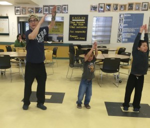 Actor Brían Wescott (Sidney) helps some 2nd graders out in Inupiaq Dance class.